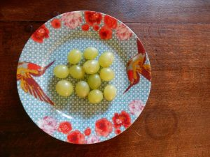 en Espagne la coutume veut de manger 12 grains de raisin aux 12 coups de minuit